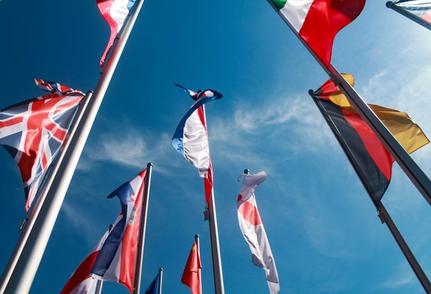 assorted nation's flags against the sky