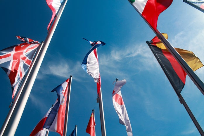 assorted nation\'s flags against the sky
