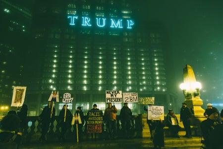 protestors at night outside of trump tower