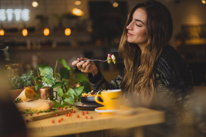 woman eating at a restaurant table