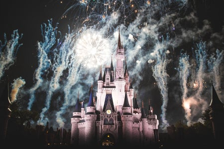 Disneyland's Sleeping Beauty Castle amid a nighttime fireworks show