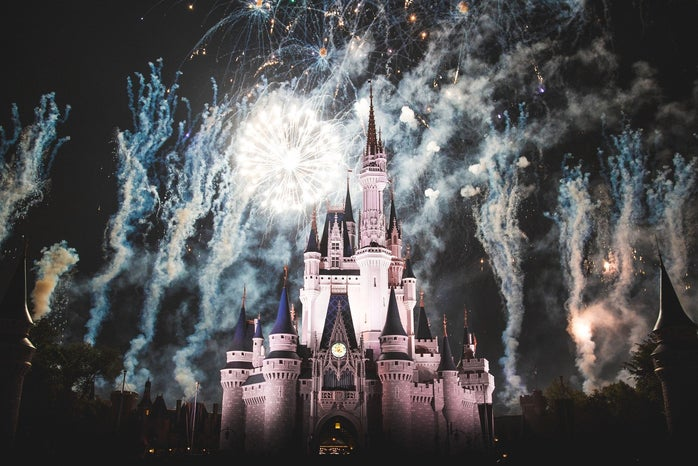 Disneyland's Sleeping Beauty Castle amid a nighttime fireworks show