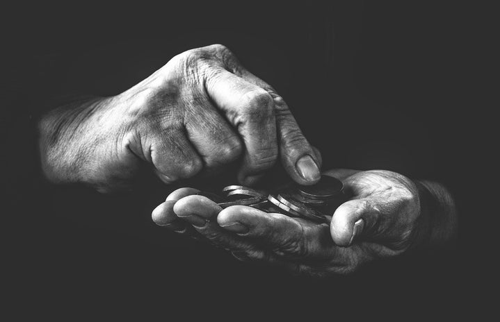black and white hands counting coins