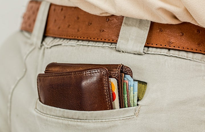wallet peaking out back pocket with credit cards