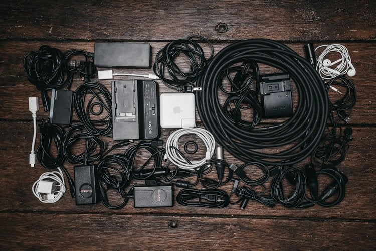 pile of coiled cables on a wooden floor or table