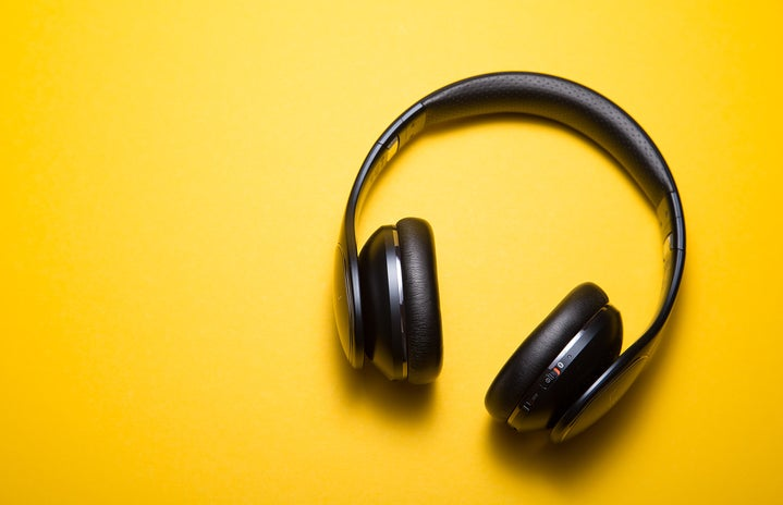 black headphones on a yellow background