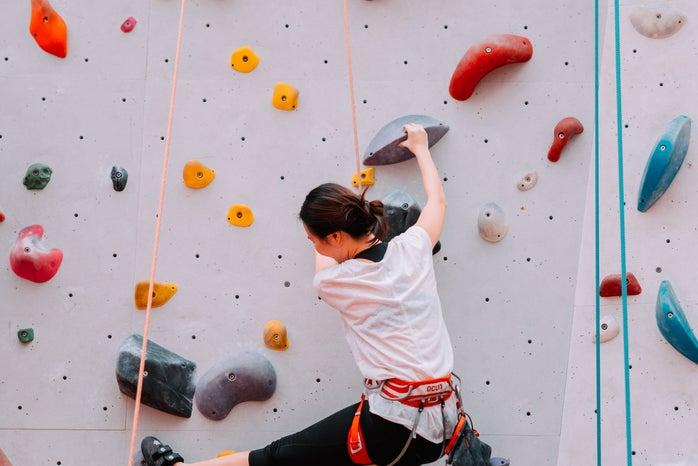 woman on rock climbing wall