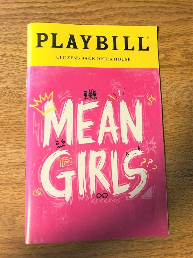 Picture of Mean Girls playbill that author went to