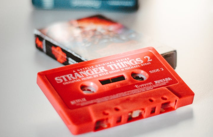 """A red cassette sits on a table labeled \""""stranger things\"""""""