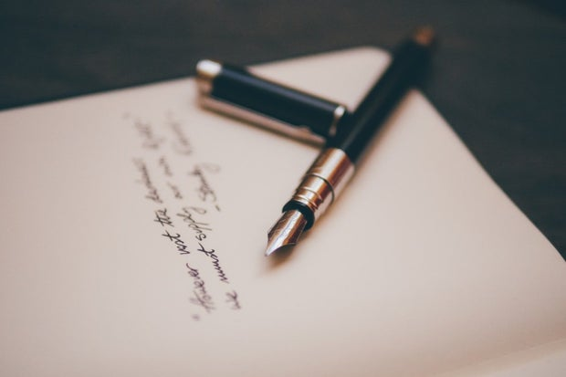 fountain pen on a letter