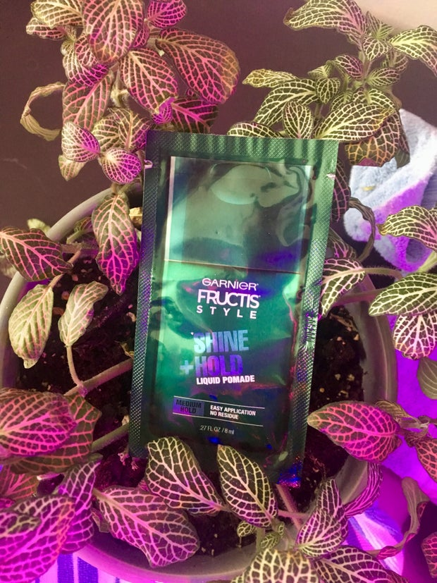 Garnier Fructis Liquid Pomade Sample in Leaves Background