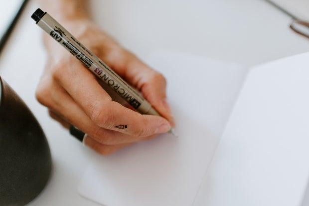Micron pen writing on white paper