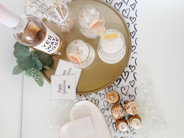 Wine with Galentine's Day cards flatlay