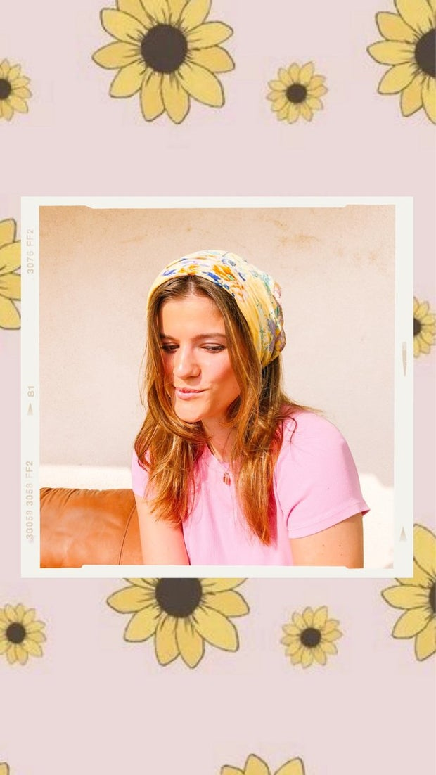 This is an image of a girl wearing a yellow bandana
