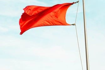 Red flag flying in wind
