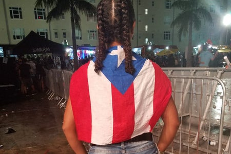 Gabriella Alexander with Puerto Rican flag cape