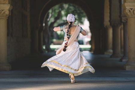 Indian girl running in the hallway