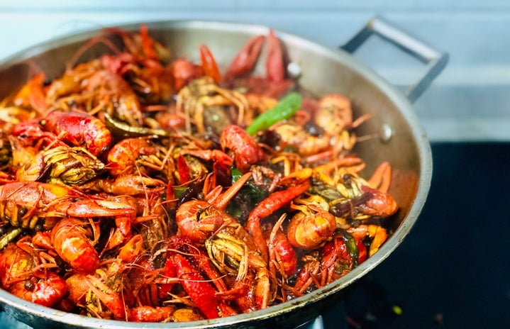 pan full of lobsters and seafood