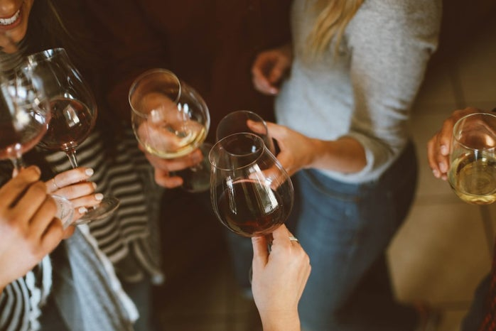 Group of girls with glasses of wine
