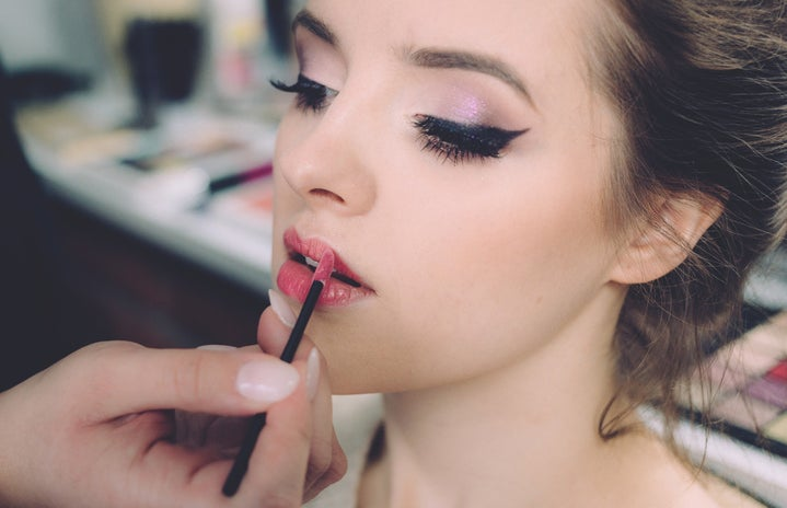 girl getting makeup done