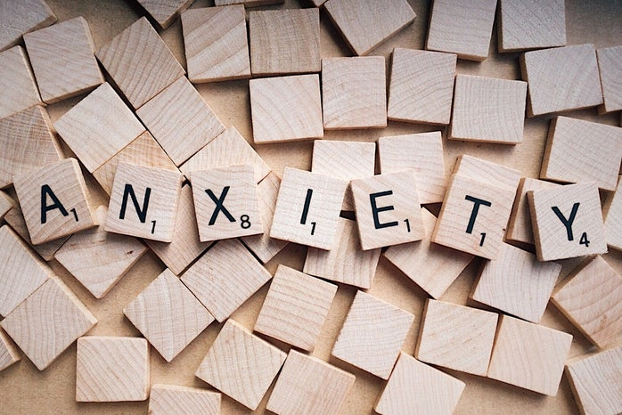 """A photo of scrabble words assembled to spell \""""anxiety\"""""""