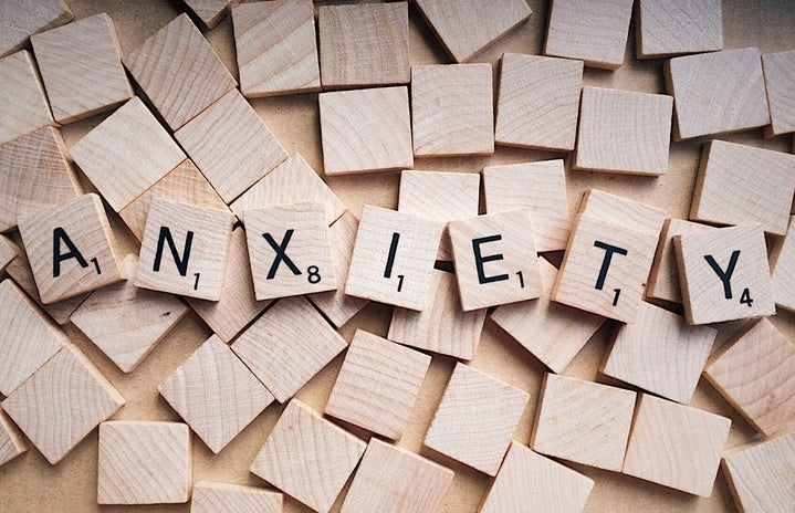 """A photo of scrabble words assembled to spell """"anxiety"""""""