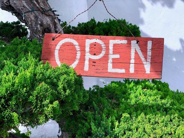 open sign near trees
