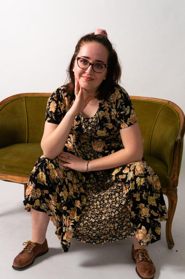 Woman model sitting in dress