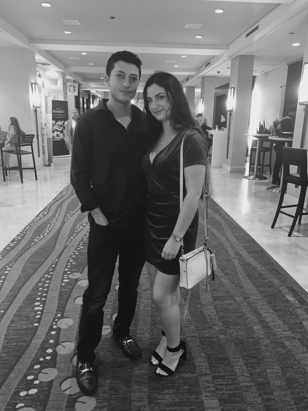 girl and guy posing for picture at hotel