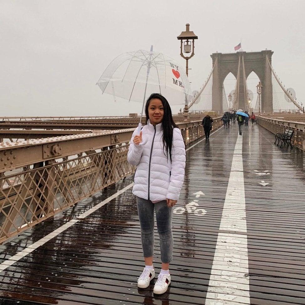girl in New York City Brooklyn Bridge