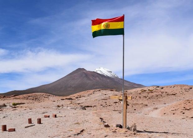 Flag of Bolivia in the desert
