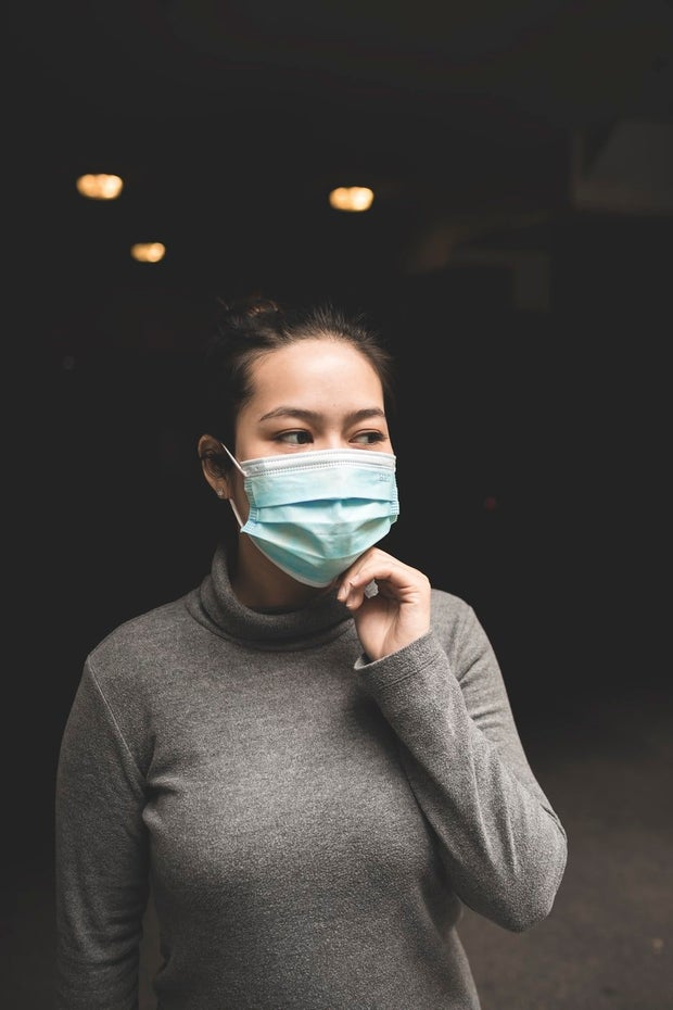 woman wearing teal face mask