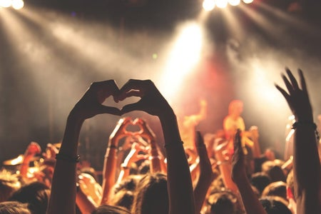 Hand heart at a concert