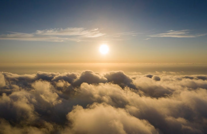 A bird\'s eye view of beautiful clouds and the sun