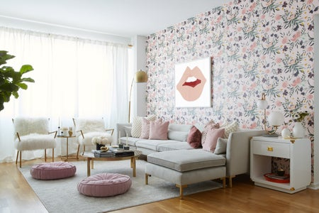 a living room heavy in white, pink and green colors.