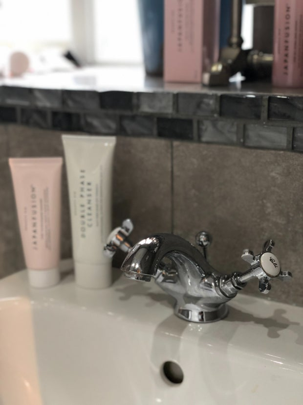 skincare products on sink counter