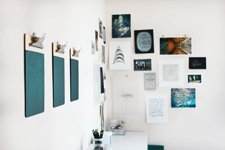 a gallery wall of small art pieces