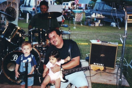 father with little kids on stage 2