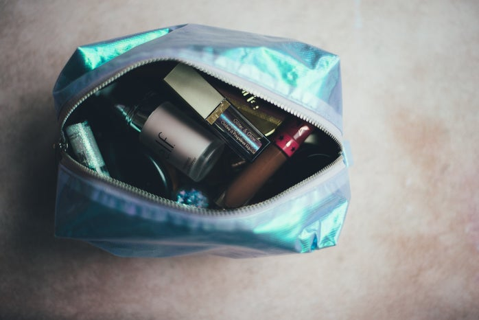 blue open makeup bag with cosmetics inside