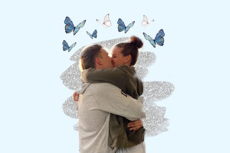Couple kissing with butterflies