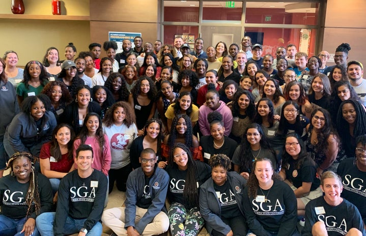 There are people wearing SGA shirts in the front. This picture was taken at SGA All-Agency Meeting