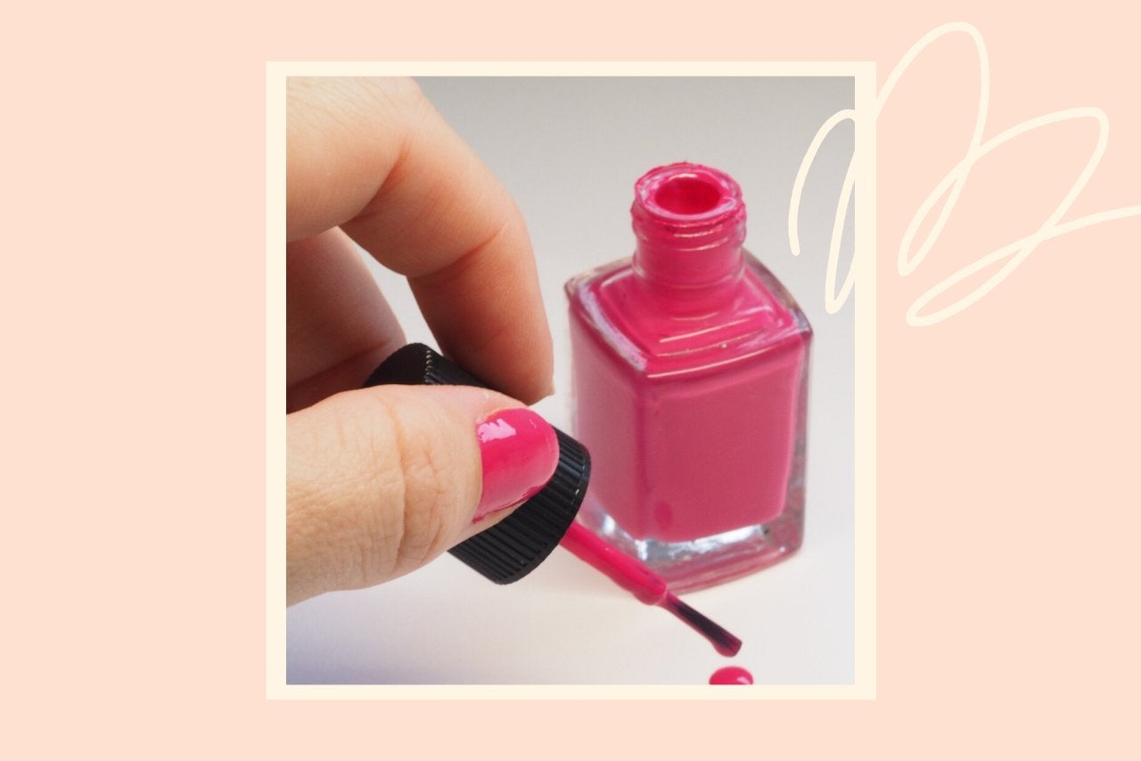 hand holding bottle of pink nail polish