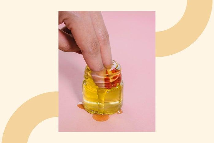 fingers in jar of oil