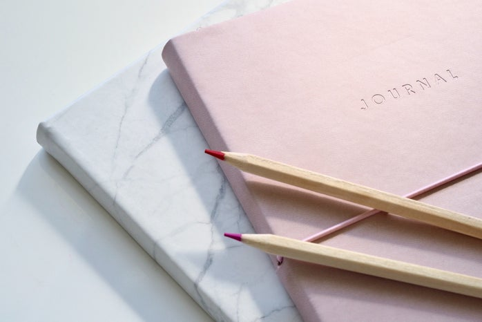 journal with two pencils