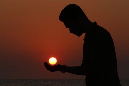 "Man ""holding"" the sun"