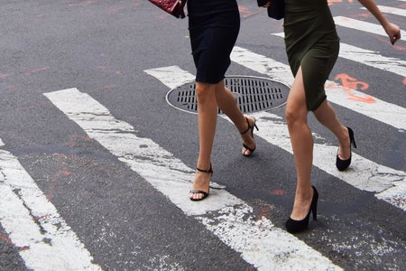 Women waling across a street in heels