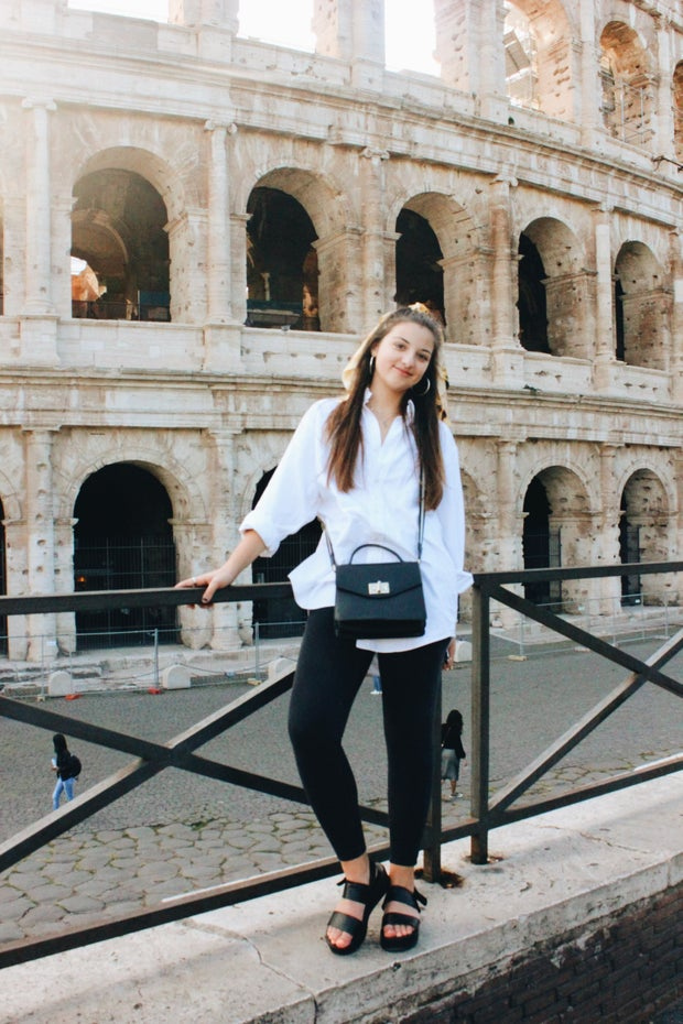 woman standing at colosseum