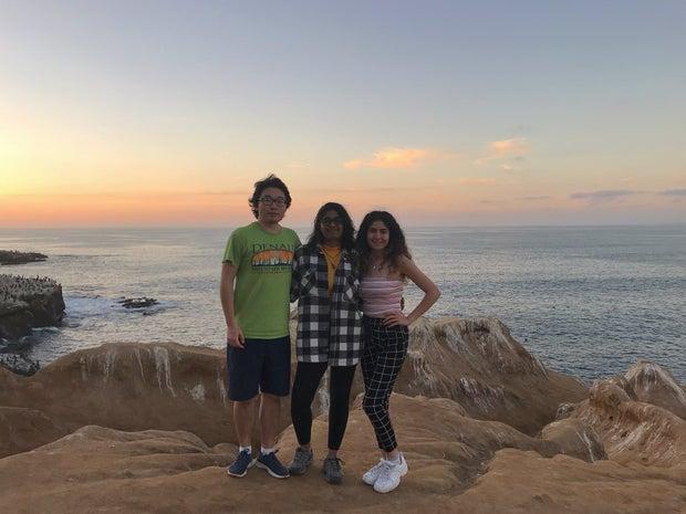 three friends standing together at La Jolla Cove