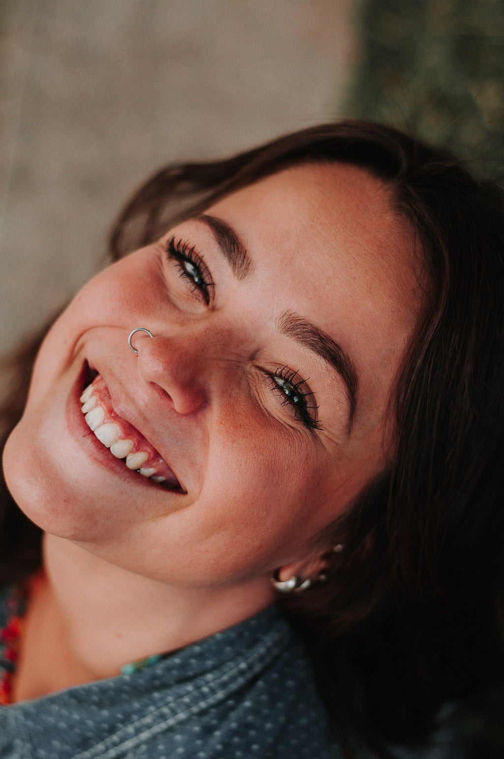 girl with nose piercing smiling