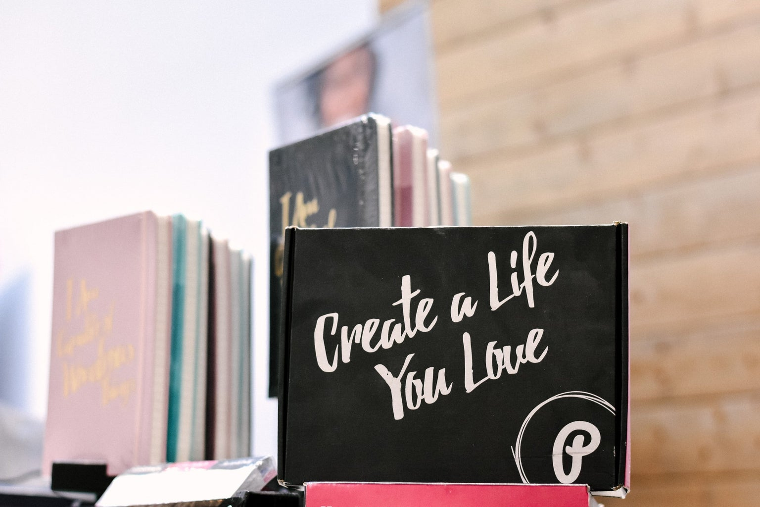"""Notebook with """"create a life you love"""" written on it"""